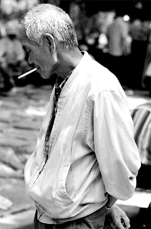 Man hanging around while smoking cigarette