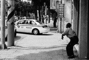 Man being surprised at police car