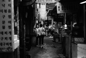 Dim alleyway with signboards