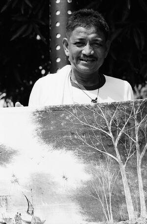 Painter selling artwork on street