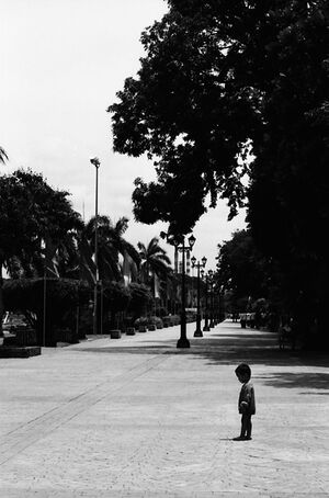 Little boy standing alone in Rizal Park
