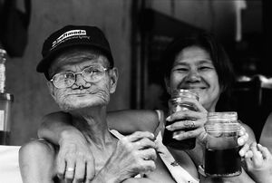 Man and woman drinking alcohol in daytime