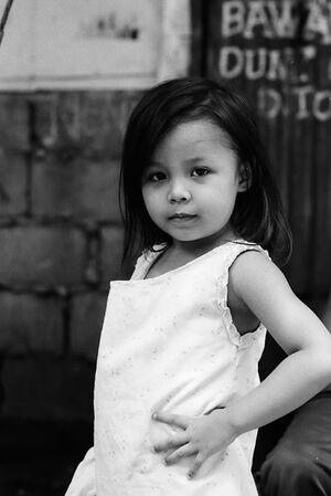 Little girl posing like a model