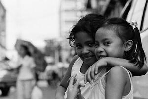 Two girls giving sideways look