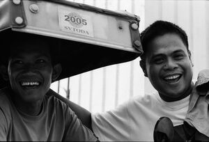 Two cheerful men enjoying chatting by roadside