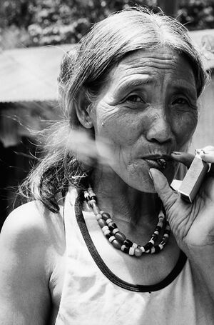 Woman puffing smoke while hlding matchbox
