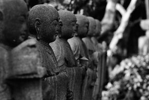 Statues of jizo standing together