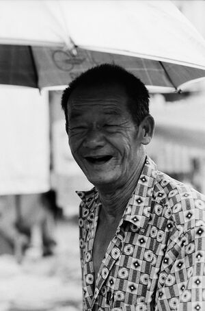 Wrinkled smile of trishaw driver