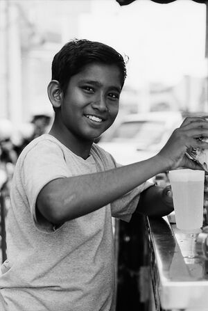 Boy making fresh juice happily