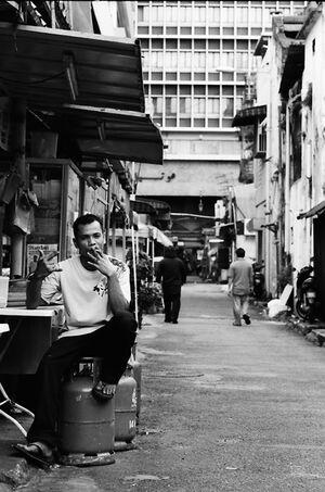 Man sitting on gas cylibders