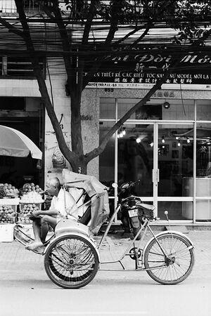 Rickshaw man sitting on seat