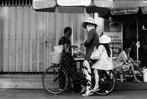Mother and daughter on same bicycle