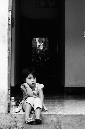 Little girl sitting at entrance