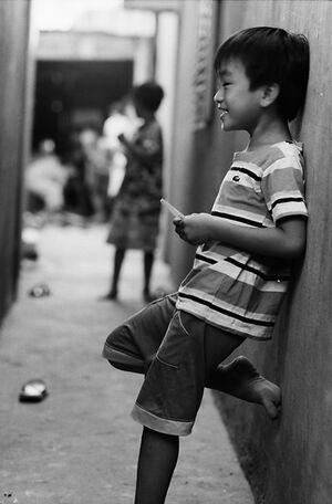 Boy laughing alone in lane
