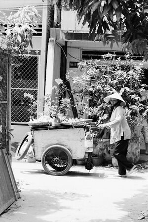 Woman peddling in residential area