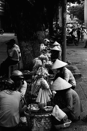 Street vendors wearing conical hat
