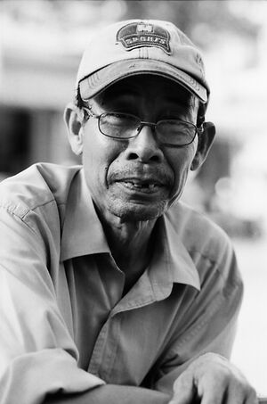 Elderly man wearing cap