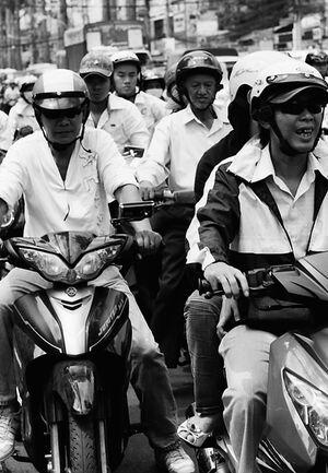 Motorbikes running street in Ho Chi Minh