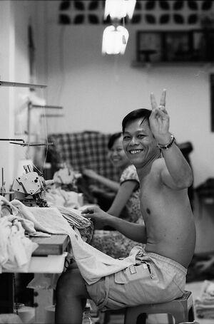 Man throwing deuce in factory