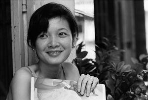 Woman smiling bashfully