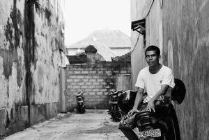 Man sitting on motorbike