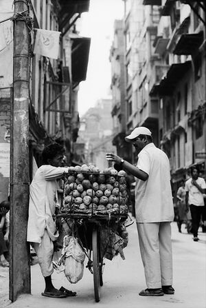 Hawker selling mangoes