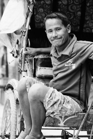 Rickshaw man waiting for customers
