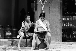Mother and son reading newspaper