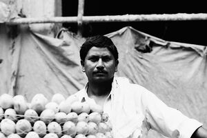 Man selling mangoes