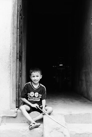 Boy sitting at entrance