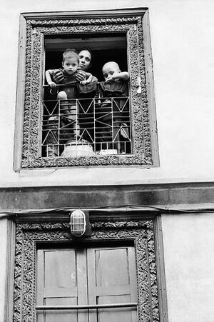 Mother and sons ralaxing by window
