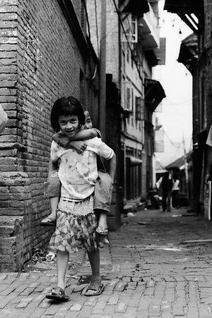 Girl carrying brother piggyback