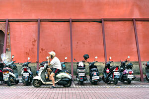 Motorbikes in front of red wall
