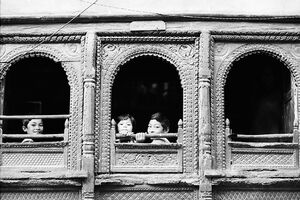 Kids sitting by window