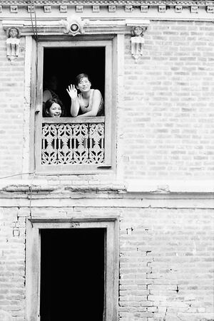 Two women by upstairs window