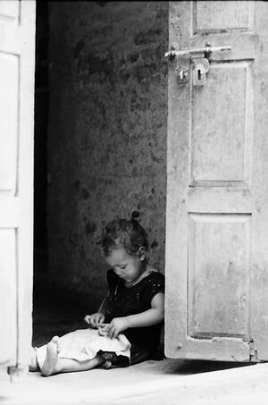 Little girl playing alone