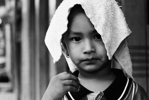 Boy putting towel on head