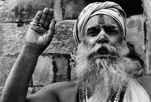Sadhu raising hand