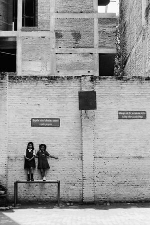 Girls leaning against wall