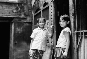 Boy and girl standing talking in lane