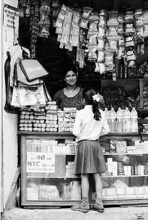Female storekeeper in general store