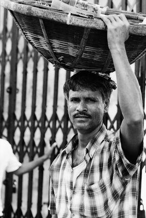 Man putting basket on head