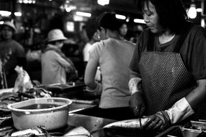 Woman working in fishmonger