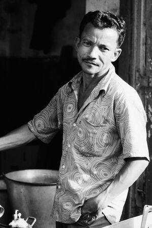 Man wearing scroll-printed shirt