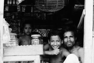 Parent and children in shop