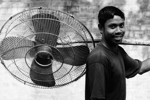 Man carrying big fan