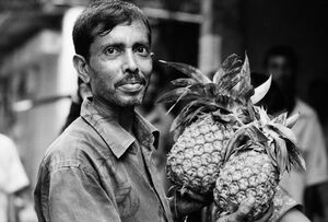 Man having two pineapples