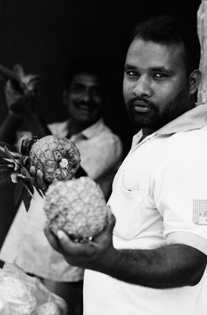 Man showing pineapple