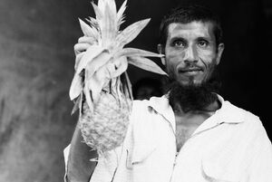 Man holding pineapple