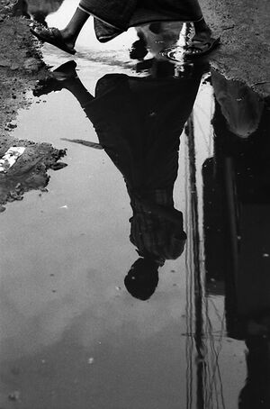 Figure reflected in puddle